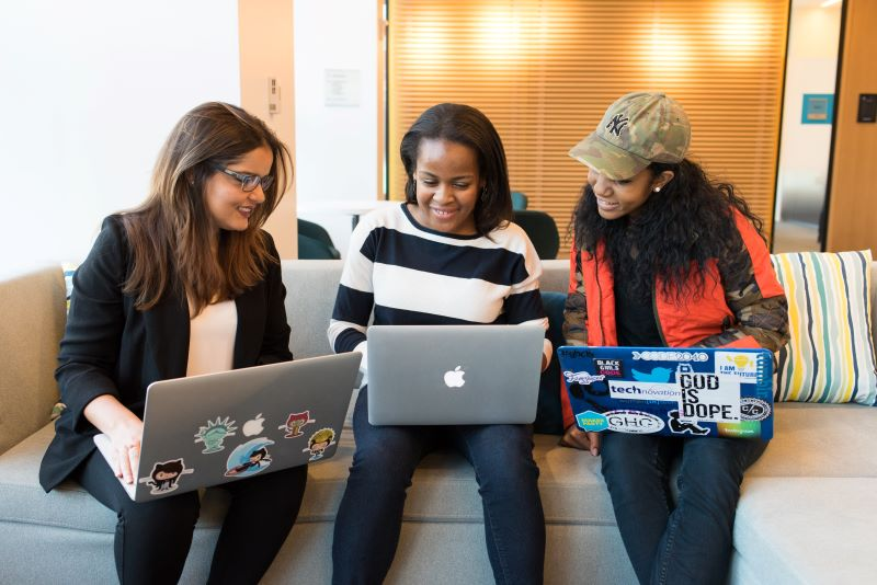 women with laptops searching the web